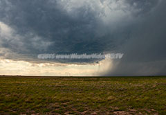 Downburst Developing wall cloud in rain free region of supercell in Colorado, along with rain foot beneath storm core.